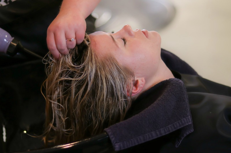 woman having her hair washed