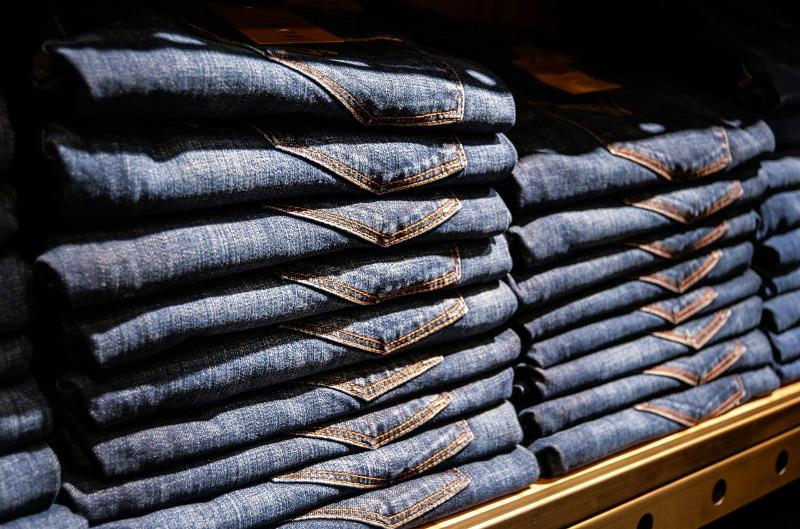 jeans folded on a shelf